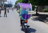 Ô che nắng xe máy - người Việt liều lĩnh