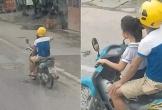 Người đàn ông để bé gái cầm lái xe máy phóng như bay trên đường