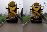 Xe trộn bê tông vừa đi vừa xả thải ra đường