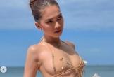 'Xỉu lên xỉu xuống' vì Ngọc Trinh khoe vòng 3 căng đét trong bộ bikini màu da tí hon