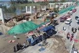 Xe buýt lao xuống sông ở Trung Quốc do mưa lũ, 13 người chết