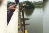 Thượng úy quân đội nhảy cầu, bơi hết tốc lực cứu cô gái đang vùng vẫy dưới sông